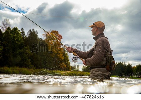 A man casts his