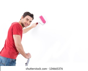 Man in casual with roller and painting wall,  portrait over white background