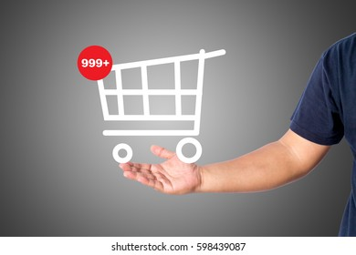 A man in casual wear holding a new item cart logo isolated over gray background with copy space for add word text title.