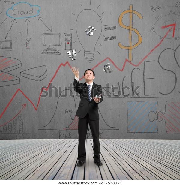 man catching and throwing money with doodles wall on wooden floor