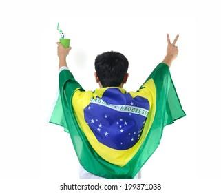 man celebrates with Brazilian flag