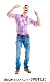 Man celebrating with hands raised - Full length portrait of a very happy young man, isolated on white background