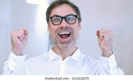 Man Celebrating Success  Gesture in Offcie