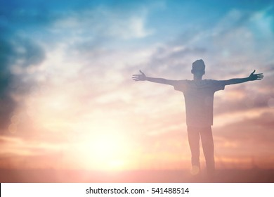 Man celebrating worship god in summer morning. Christian thought positive over sunset inspire praise for peace cross concept for freedom financial, vision and mission, self motivation, hope life love