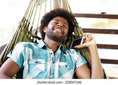 man with cellphone in the hammock