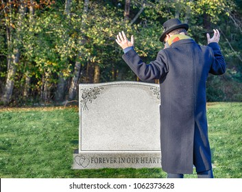 Man at cemetery is overcome with grief