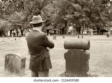 Man in cemetery ponders the afterlife