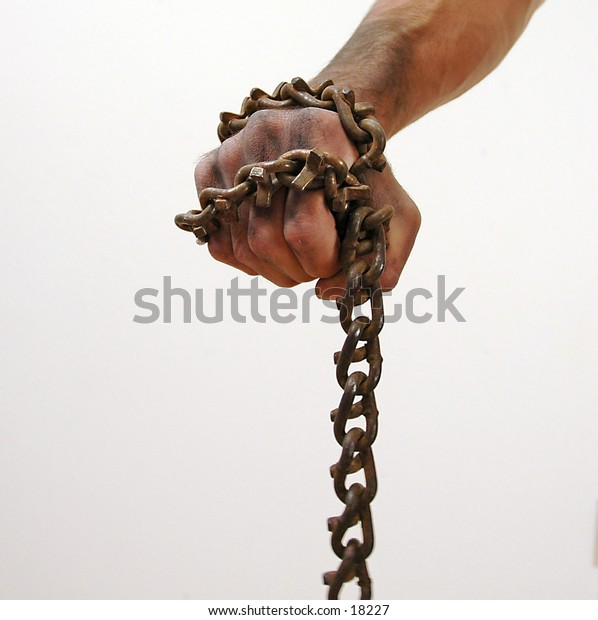 man with chains in his hands