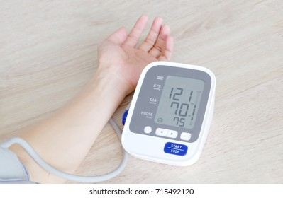 A man check blood pressure monitor and heart rate monitor with digital pressure gauge. Health concept