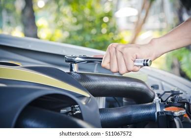 Man check and repair the car engine.