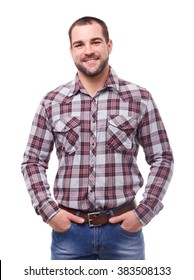 Man in checked shirt with hands in pockets. Isolated on white background