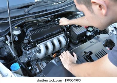 A man checking car engine