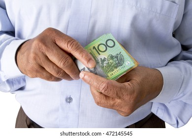 Man checking or counting Australian dollars in hand. Notes include $100, $50, and $10.