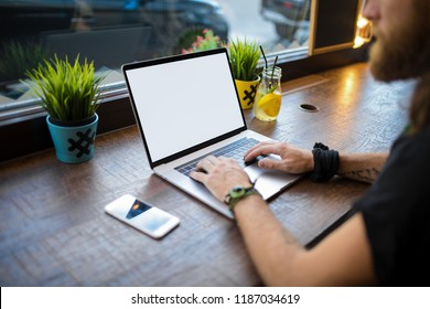Man checking e-mail on laptop computer with empty white copy space on the screen background for promotional content. Male business online worker using applications on netbook. Learning via notebook