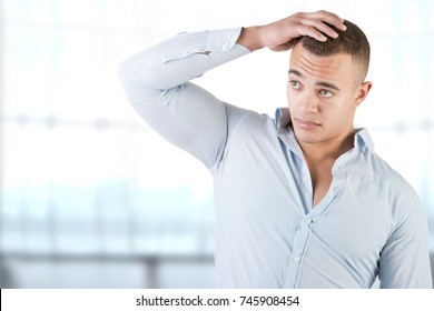 Man checking is hair in a blue background