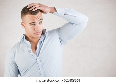 Man checking is hair, isolated in grey