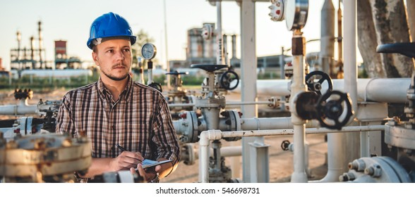 Man checking manometer in natural gas factory
