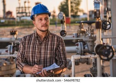 Man checking manometer in natural gas factory