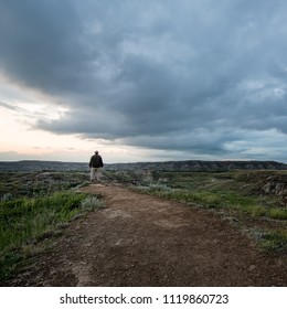 Man checking out the view in Dinosaur provincial park in Alberta, Canada.