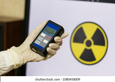 Man checking radiation with geiger counter. Concept - radiation hazard, pollution