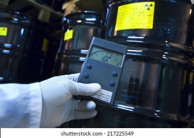 Man checking radiation with geiger counter