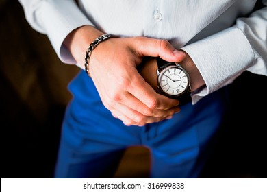 Man checking the time on his wrist watch