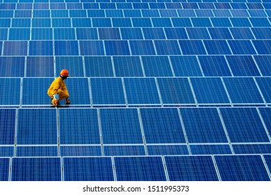 A man checking,repair solar module system .the concept of working on solar cell panel background.