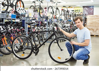 Man checks a bike before buying in the sports shop