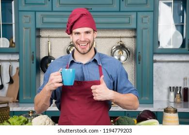 Man chef hold mug drink beverage. Great taste. Chef prepared delicious hot beverage. Beverage drink recipe. Smoothie healthy beverage concept. Man chef wear apron cooking in professional kitchen.