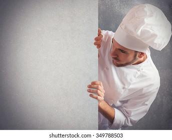 Man chef looks at a big billboard