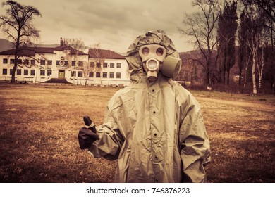 a man in a chemical protection suit. man in a gas mask.