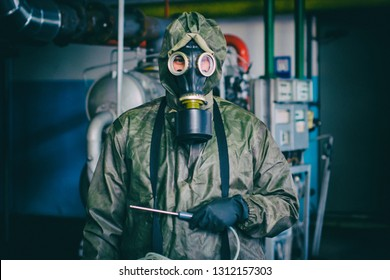 Man in chemical protection suit  with radiation dosimeter