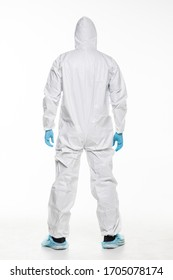 Man in chemical protective suit making stop gesture on white background. Virus.