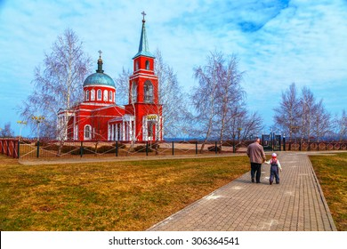 man with a child go to  Orthodox church in  spring