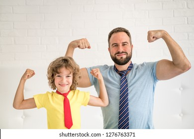 Man and child at home. Father and kid having fun together. Family holiday concept. Happy Father's day