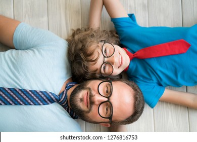 Man and child at home. Father and kid having fun together. Family holiday concept. Happy Father's day. Top view portrait