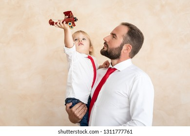 Man and child at home. Father and son having fun together. Family holiday concept. Happy Father's day