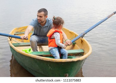 man with a child on the boat
