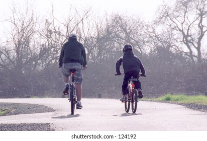 Man & Child riding bikes