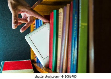 man choose ebook among paper books. new technology concept