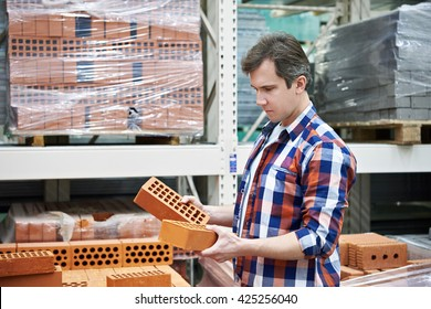 Man chooses a building brick in the store