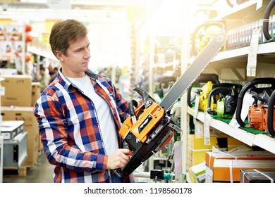 Man chooses a gasoline saw in store