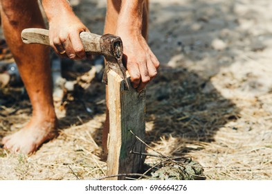 Man chopping wood in nature, close-up axe