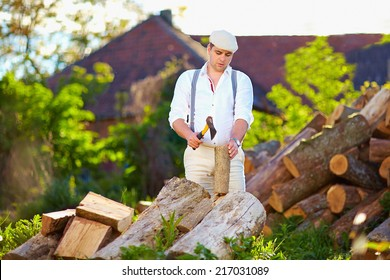 man chopping wood on the backyard