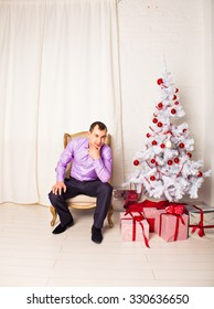 man with Christmas tree at home