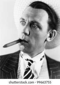 Man with a cigar in his mouth looking surprised