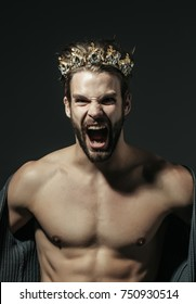 Man or cinderella prince in crown shout on grey background. Fashion, jewelry, accessory. Freak, gay and transvestite with naked torso. Drag queen, homosexual and trans.