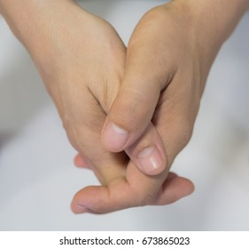 Man clasped hands.