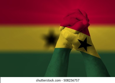 Man clasped hands patterned with the GHANA flag