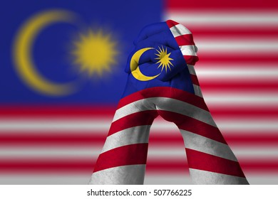 Man clasped hands patterned with the MALAYSIA flag
